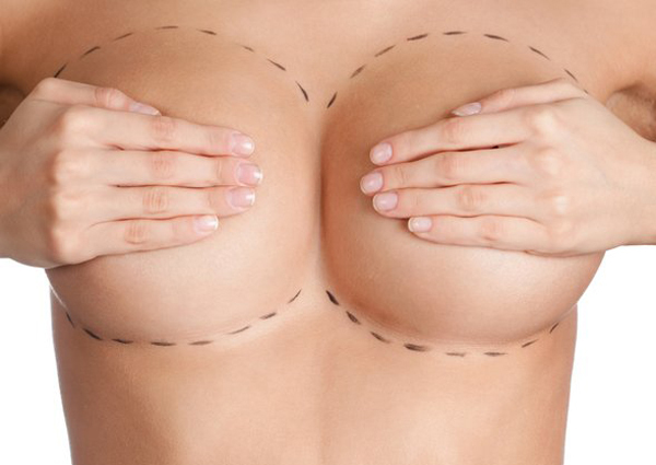 woman covering her breasts preparing for surgery