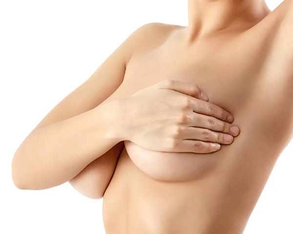 woman covering her breasts with her hand